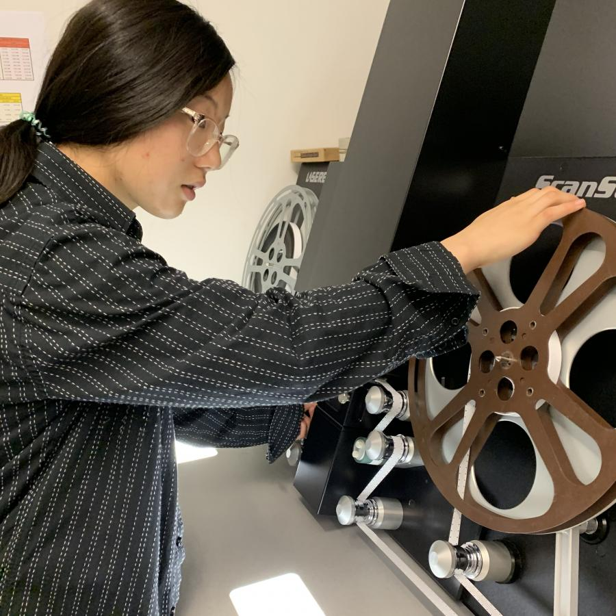 Summer Work Experience Program student, Arvin Zhang, setting up the film scanner.