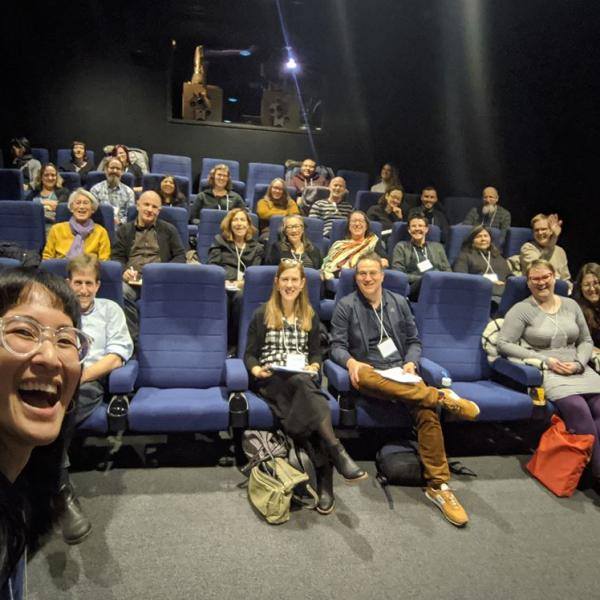A selfie taken by Sennah Yee during the Fantastic Finds screening at the December Symposium